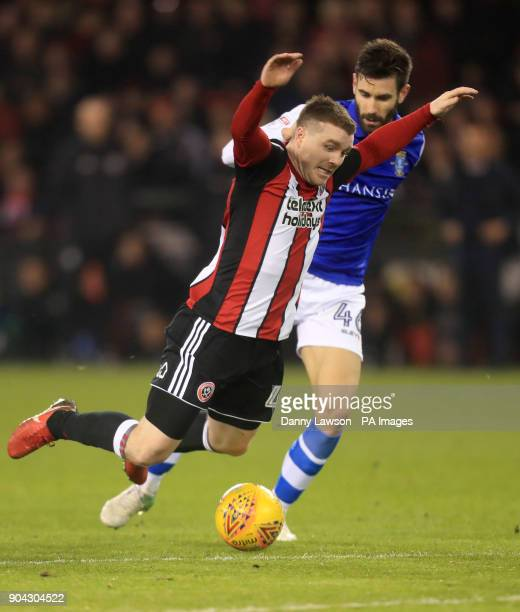 Sheffield United's John Fleck and Sheffield Wednesday's Frederico Venancio during the Sky Bet Championship match at Bramall Lane Sheffield