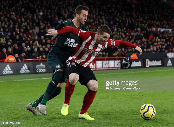 Sheffield United's John Fleck shields the ball from Newcastle United's Javi Manquillo during the Premier League match between Sheffield United and...