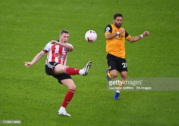 Sheffield United's John Lundstram and Wolverhampton Wanderers' Joao Moutinho during the Premier League match at Bramall Lane, Sheffield.