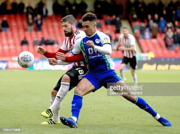 Sheffield United's Kieron Freeman is tackled by Wigan Athletic's Antonee Robinson Sheffield United v Wigan Athletic Sky Bet Championship Bramall Lane