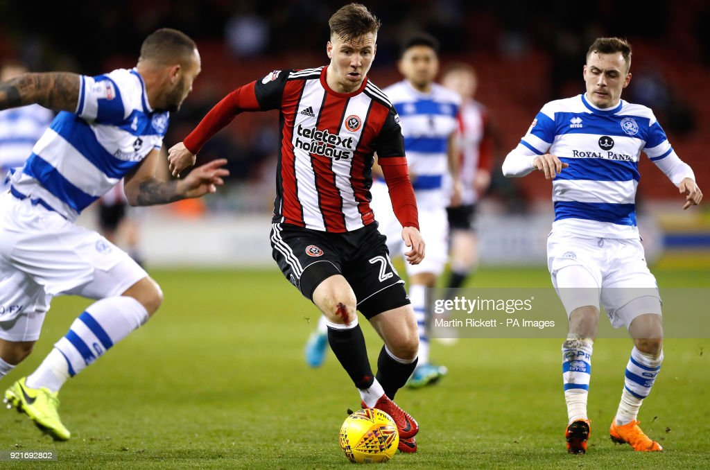 Sheffield United's Lee Evans battles for the ball with Queens Park Rangers' Josh Scowen during the Sky Bet Championship match at Bramall Lane, Sheffield.
