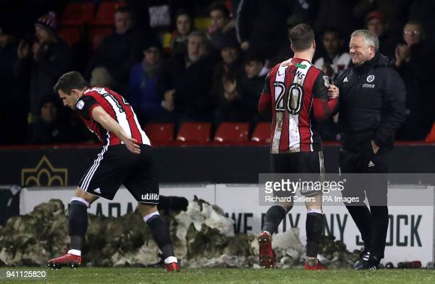 Sheffield United's Lee Evans shakes hands with manager Chris Wilder as he is substituted off for teammate Ryan Leonard during the Championship match...