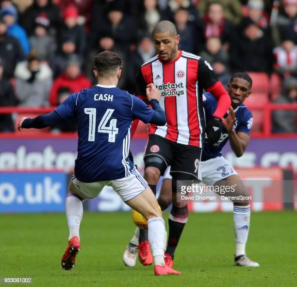 Sheffield United's Leon Clarke battles between Nottingham Forest's Matty Cash and Tendayi Darikwa during the Sky Bet Championship match between...