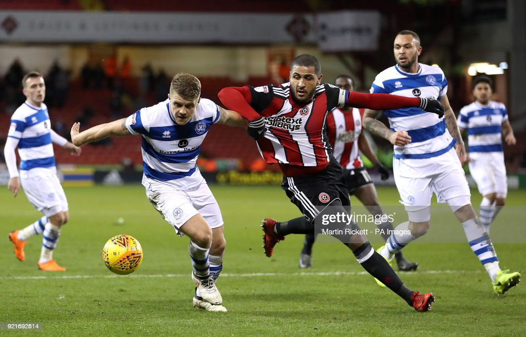 Sheffield United's Leon Clarke battles for the ball with Queens Park Rangers' Jake Bidwell during the Sky Bet Championship match at Bramall Lane, Sheffield.