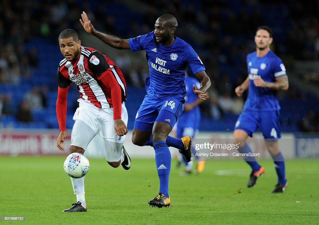 Sheffield United's Leon Clarke vies for possession with Cardiff City's Souleymane Bamba during the Sky Bet Championship match between Cardiff City and Sheffield United at Cardiff City Stadium on August 15, 2017 in Cardiff, Wales.