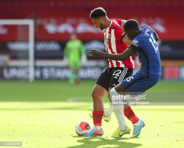 Sheffield United's Lys Mousset shields the ball from Chelsea's Kurt Zouma during the Premier League match between Sheffield United and Chelsea FC at...
