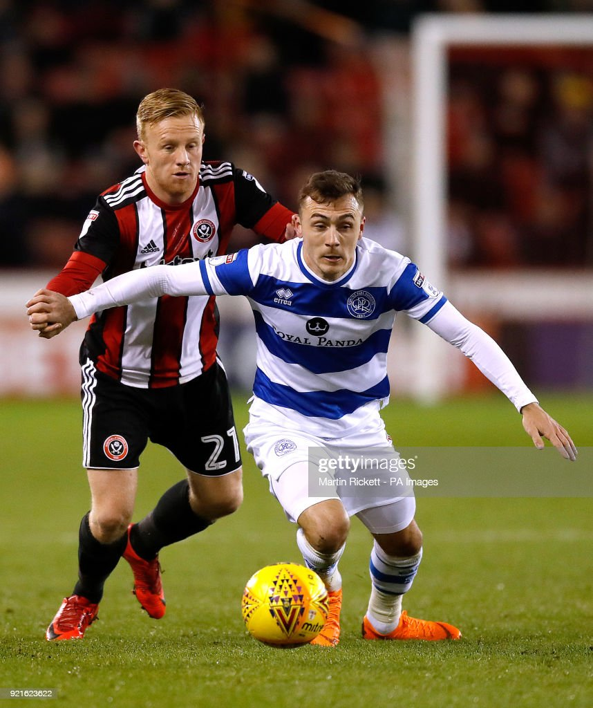 Sheffield United's Mark Duffy battles for the ball with Queens Park Rangers' Josh Scowen (right) during the Sky Bet Championship match at Bramall Lane, Sheffield.