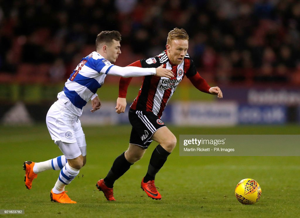 Sheffield United's Mark Duffy battles for the ball with Queens Park Rangers' Josh Scowen (left) during the Sky Bet Championship match at Bramall Lane, Sheffield.