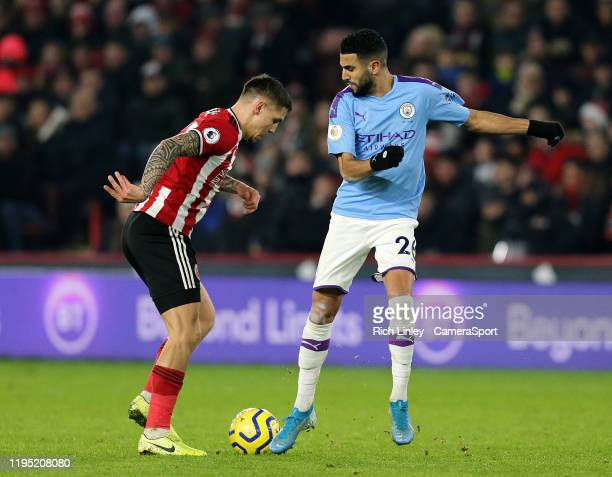 SHEFFIELD ENGLAND JANUARY Sheffield United's Muhamed Besic vies for possession with Manchester City's Riyad Mahrez during the Premier League match...