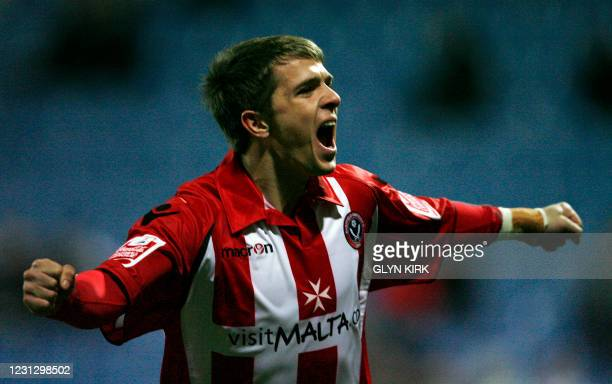 Sheffield United's Northern Ireland striker Jamie Ward celebrates scoring a goal during their FA Cup third round replay football match against Queens...