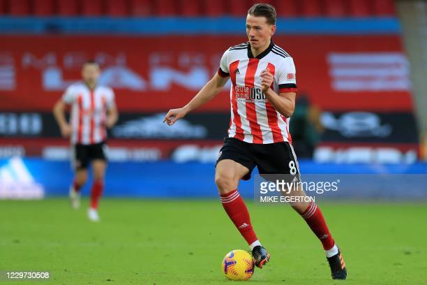 Sheffield United's Norwegian midfielder Sander Berge runs with the ball during the English Premier League football match between Sheffield United and...