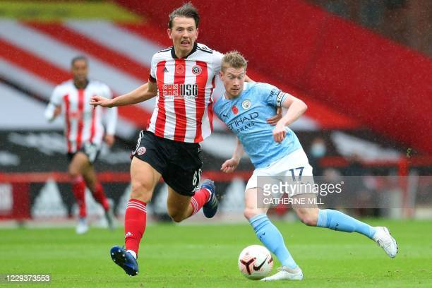 Sheffield United's Norwegian midfielder Sander Berge vies with Manchester City's Belgian midfielder Kevin De Bruyne during the English Premier League...