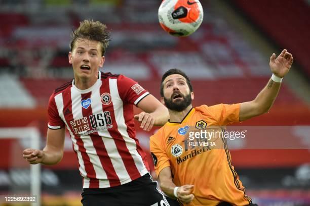 Sheffield United's Norwegian midfielder Sander Berge vies with Wolverhampton Wanderers' Portuguese midfielder Joao Moutinho during the English...