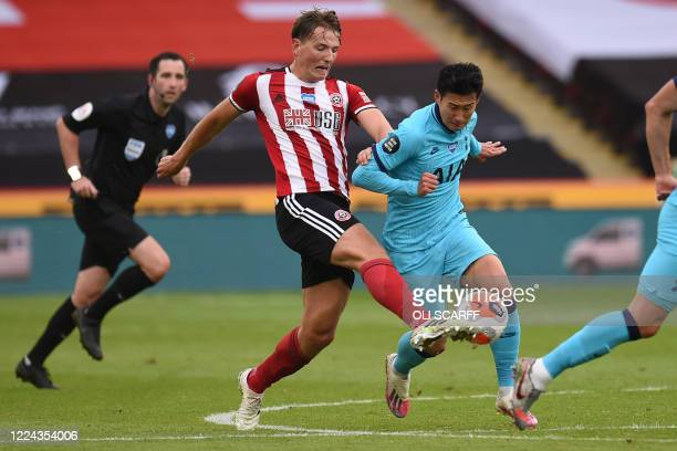 Sheffield United's Norwegian midfielder Sander Berge vies with Tottenham Hotspur's South Korean striker Son Heung-Min during the English Premier...