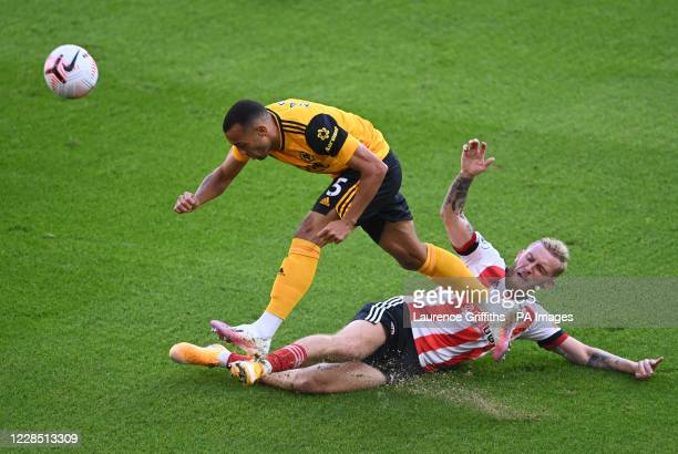 Sheffield United's Oliver McBurnie challenges Wolverhampton Wanderers' Fernando Marcal during the Premier League match at Bramall Lane, Sheffield.