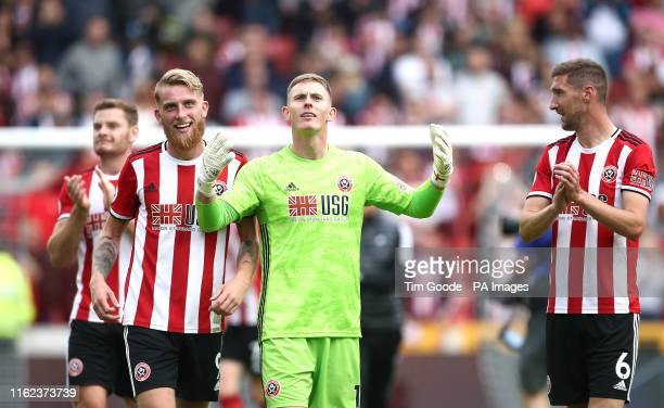 Sheffield United's Oliver McBurnie goalkeeper Dean Henderson and Chris Basham celebrates with teammates after the final whistle during the Premier...