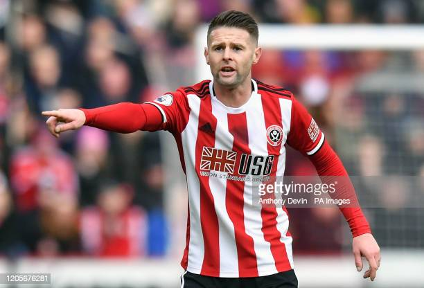 Sheffield United's Oliver Norwood gestures to his teammates during the Premier League match at Bramall Lane, Sheffield.
