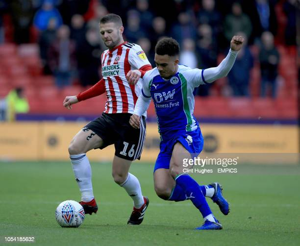 Sheffield United's Ollie Norwood is tackled by Wigan Athletic's Antonee Robinson Sheffield United v Wigan Athletic Sky Bet Championship Bramall Lane