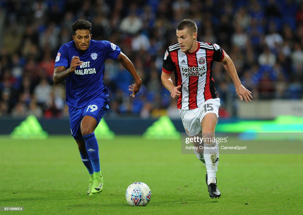 Sheffield United's Paul Coutts vies for possession with Cardiff City's Nathaniel Mendez-Laing during the Sky Bet Championship match between Cardiff City and Sheffield United at Cardiff City Stadium on August 15, 2017 in Cardiff, Wales.