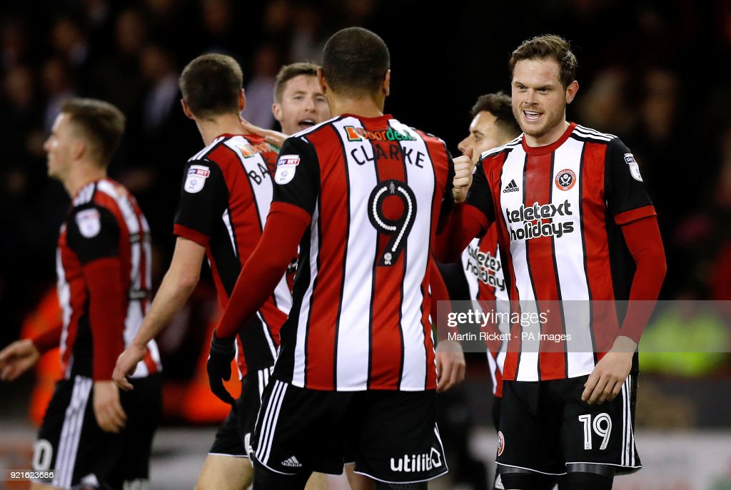 Sheffield United's Richard Stearman (right) celebrates scoring his side's first goal of the game during the Sky Bet Championship match at Bramall Lane, Sheffield.