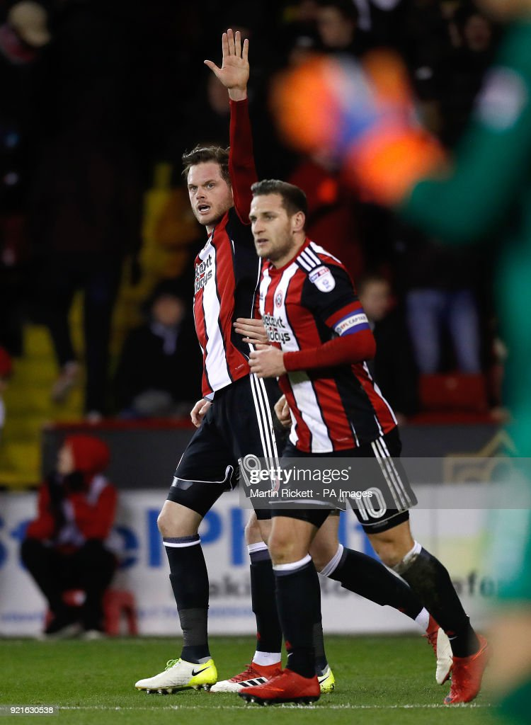 Sheffield United's Richard Stearman (left) celebrates scoring his side's first goal of the game during the Sky Bet Championship match at Bramall Lane, Sheffield.
