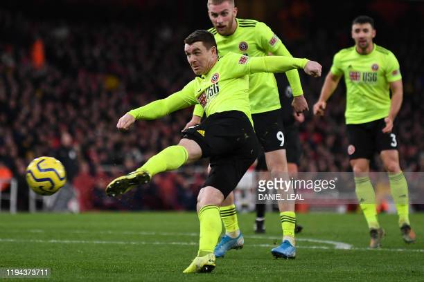 Sheffield United's Scottish midfielder John Fleck scores the equalising goal during the English Premier League football match between Arsenal and...