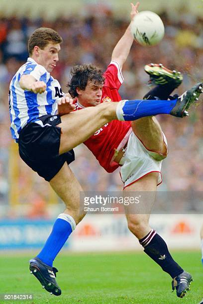 Sheffield Wednesday captain Nigel Pearson challenges Mark Hughes of Manchester United during the 1991 League Cup Final between Sheffield Wednesday...