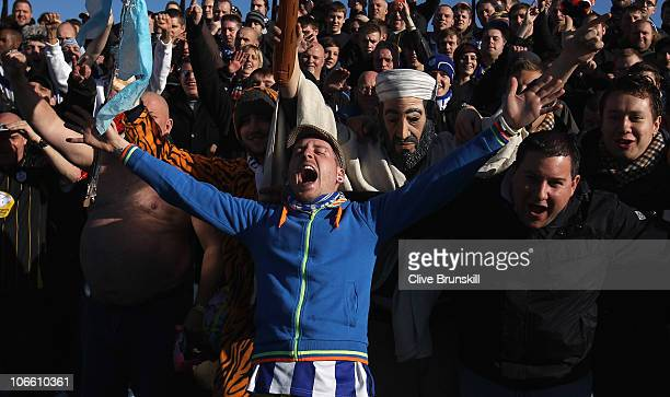 Sheffield Wednesday fans sing during the FA Cup sponsored by E.ON first Round match between Southport and Sheffield Wednesday at Haig Avenue on...