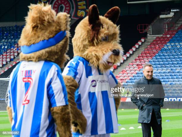 Sheffield Wednesday manager Carlos Carvalhal walks past the Huddersfield Town mascots prior to the Sky Bet Championship Play-Off Semi Final First Leg...