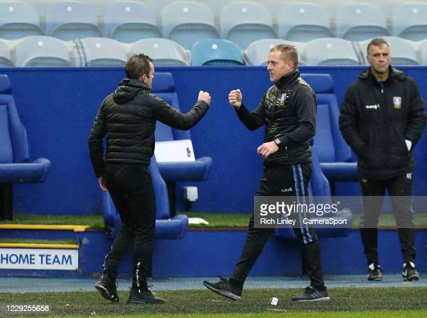 Sheffield Wednesday manager Garry Monk congratulates Luton Town manager Nathan Jones at the final whistle during the Sky Bet Championship match...