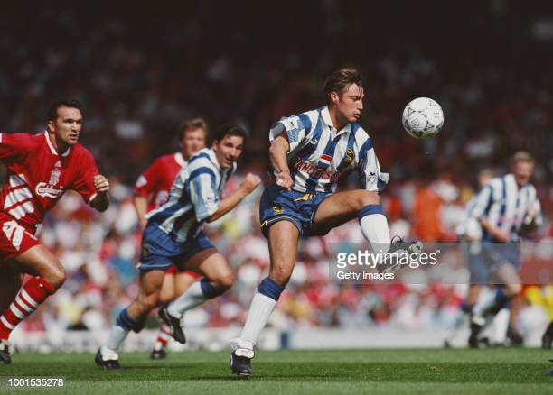 Sheffield Wednesday player Paul Warhurst in action watched by from left, Neil Ruddock, Jan Molby and David Hirst during a Premier League match...