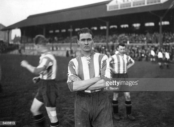 Sheffield Wednesday player, W Marsden on the pitch with his team mates before a match.