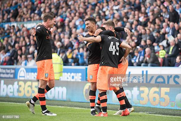 Sheffield Wednesday players celebrate after Fernando Forestieri scores a penalty during the Sky Bet Championship match between Huddersfield Town and...