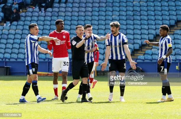Sheffield Wednesday players remonstrate with referee Tony Harrington after Bristol City's Henri Lansbury tipped a first half effort over the bar with...