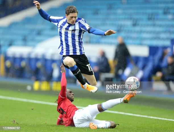 Sheffield Wednesday's Adam Reach is tackled by Queens Park Rangers' Osman Kakay during the Sky Bet Championship match between Sheffield Wednesday and...