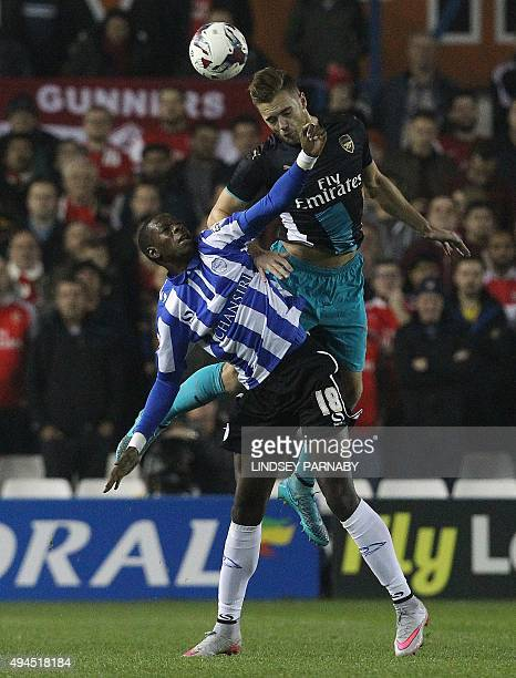 Sheffield Wednesday's Angolan striker Lucas Joao vies with Arsenal's English defender Calum Chambers during the English League Cup fourth round...