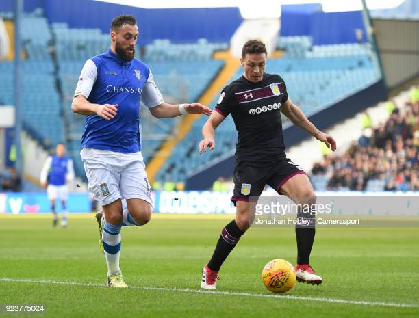 Sheffield Wednesday's Atdhe Nuhiu and Aston Villa's James Chester during the Sky Bet Championship match between Sheffield Wednesday and Aston Villa...