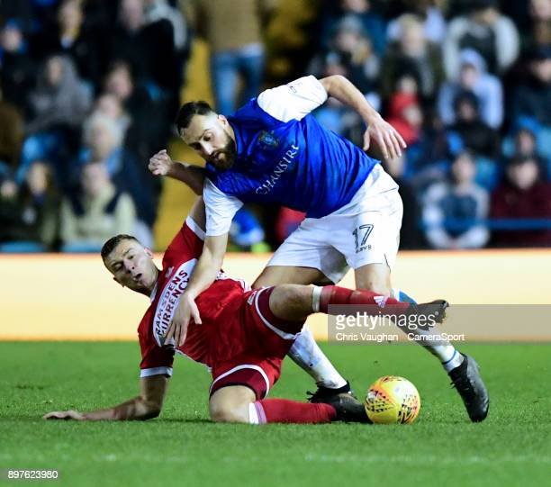 Sheffield Wednesday's Atdhe Nuhiu is tackled by Middlesbrough's Ben Gibson during the Sky Bet Championship match between Sheffield Wednesday and...