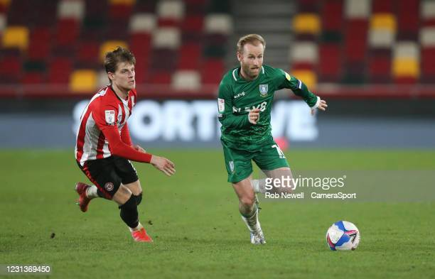 Sheffield Wednesday's Barry Bannan and Brentford's Mathias Jensen during the Sky Bet Championship match between Brentford and Sheffield Wednesday at...