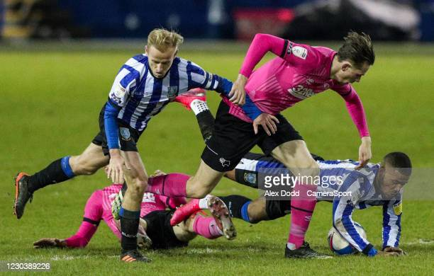 Sheffield Wednesday's Barry Bannan and Elias Kachunga battle with Derby County's Max Bird and Jason Knight during the Sky Bet Championship match...