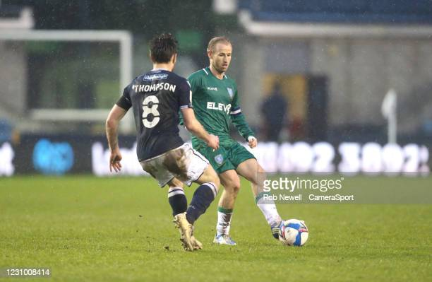 Sheffield Wednesday's Barry Bannan and Millwall's Ben Thompson during the Sky Bet Championship match between Millwall and Sheffield Wednesday at The...