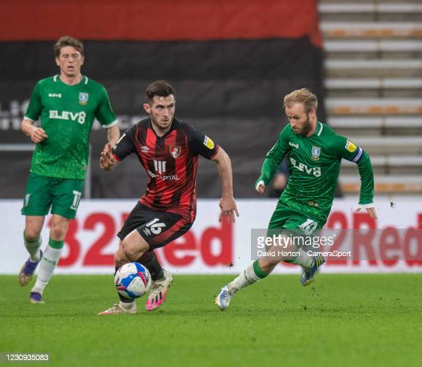 Sheffield Wednesday's Barry Bannan & Bournemouth's Lewis Cook during the Sky Bet Championship match between AFC Bournemouth and Sheffield Wednesday...