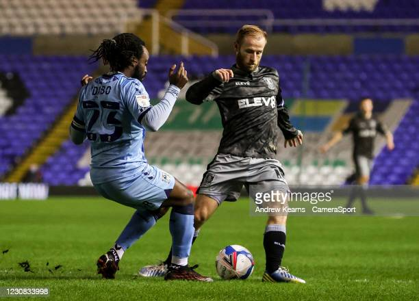 Sheffield Wednesday's Barry Bannan competing with Coventry City's Fankaty Dabo during the Sky Bet Championship match between Coventry City and...