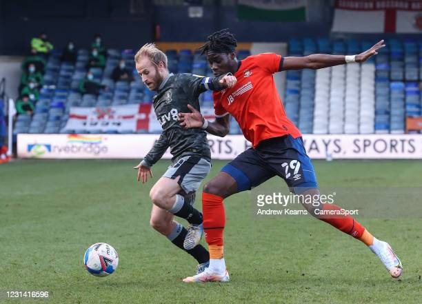 Sheffield Wednesday's Barry Bannan competing with Luton Town's Elijah Adebayo during the Sky Bet Championship match between Luton Town and Sheffield...