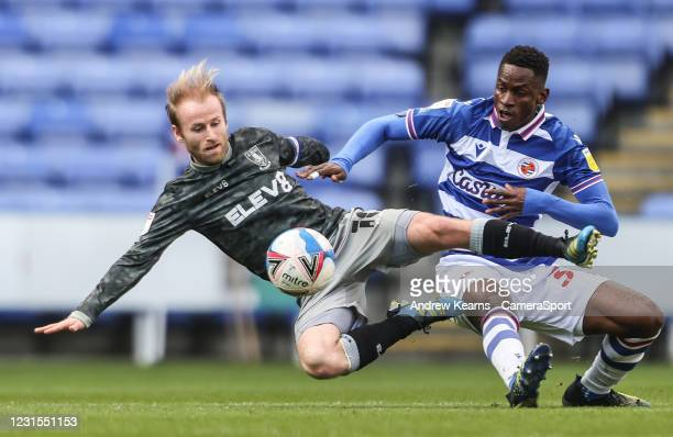 Sheffield Wednesday's Barry Bannan competing with Reading's Alfa Semedo during the Sky Bet Championship match between Reading and Sheffield Wednesday...