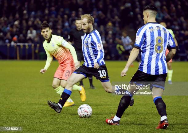 Sheffield Wednesday's Barry Bannan under pressure from Manchester City's David Silva during the FA Cup Fifth Round match between Sheffield Wednesday...