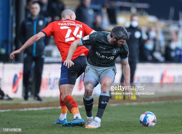 Sheffield Wednesday's Callum Paterson competing with Luton Town's Kal Naismith during the Sky Bet Championship match between Luton Town and Sheffield...