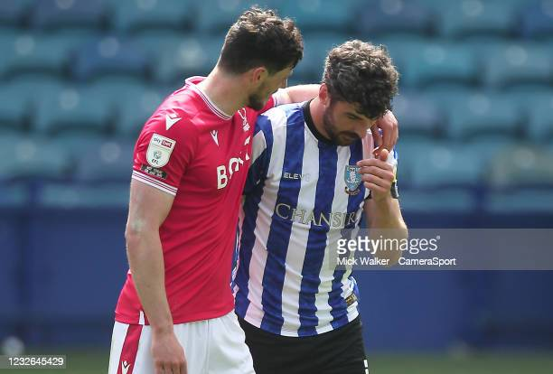 Sheffield Wednesday's Callum Paterson is consolded by Nottingham Forest's Scott McKenna during the Sky Bet Championship match between Sheffield...