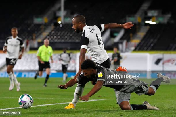 Sheffield Wednesday's Congolese striker Elias Kachunga vies with Fulham's Belgian defender Denis Odoi during the English League Cup third round...