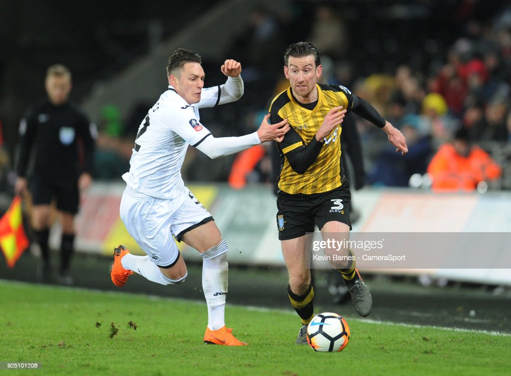 Sheffield Wednesday's David Jones under pressure from Swansea City's Connor Roberts during the The Emirates FA Cup Fifth Round Replay match between Swansea City and Sheffield Wednesday at Liberty Stadium on February 27, 2018 in Swansea, Wales.